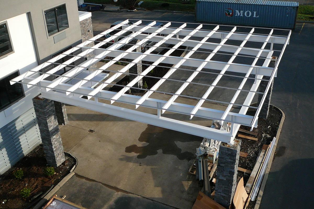 Flat Roof Porte Cochere Installed On Existing Steel Subframe
