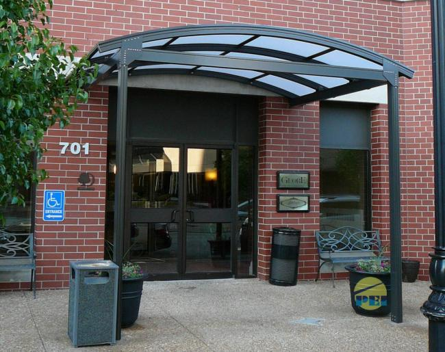Arched Roof Porte Cochere Installed On Existing Steel Subframe