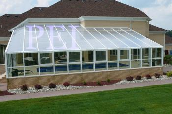 Residential pool enclosures swimming pools glass sunrooms for Indoor pool with retractable roof