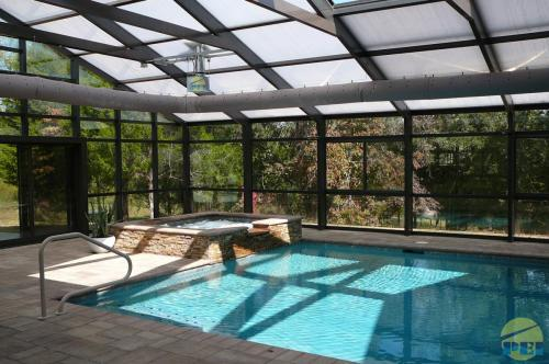 Residential pool enclosures swimming pools glass sunrooms retractable Retractable swimming pool enclosures